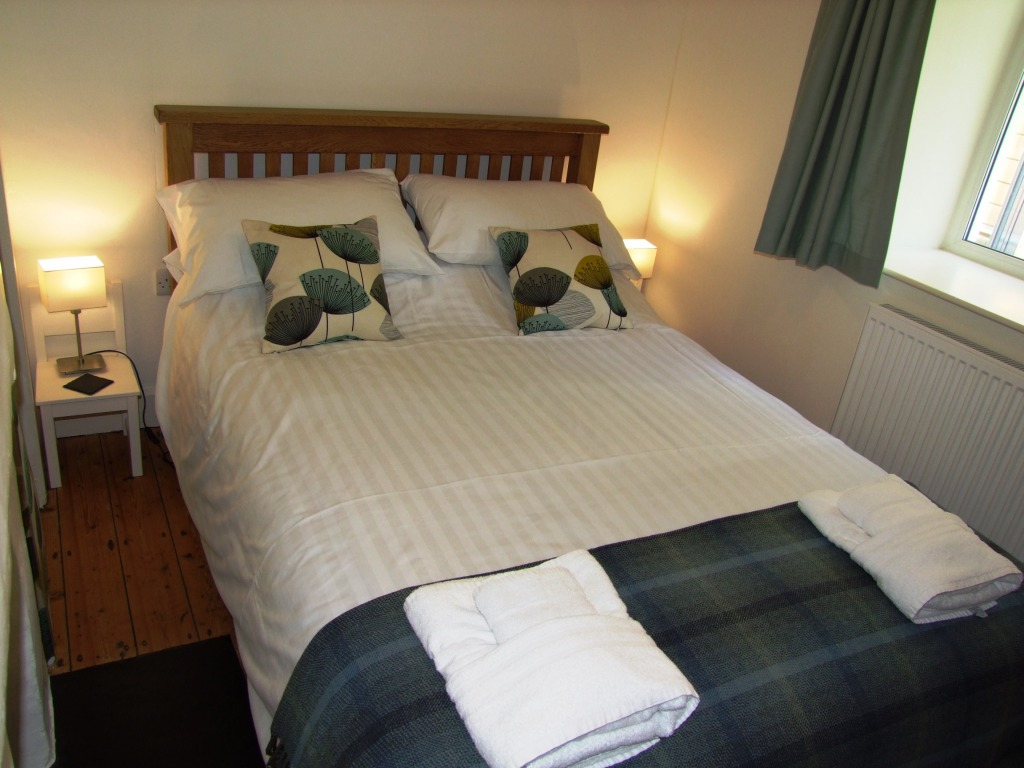 Fourth bedroom with standard sized double bed