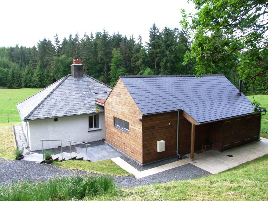 From the back, the new extension and old cottage.